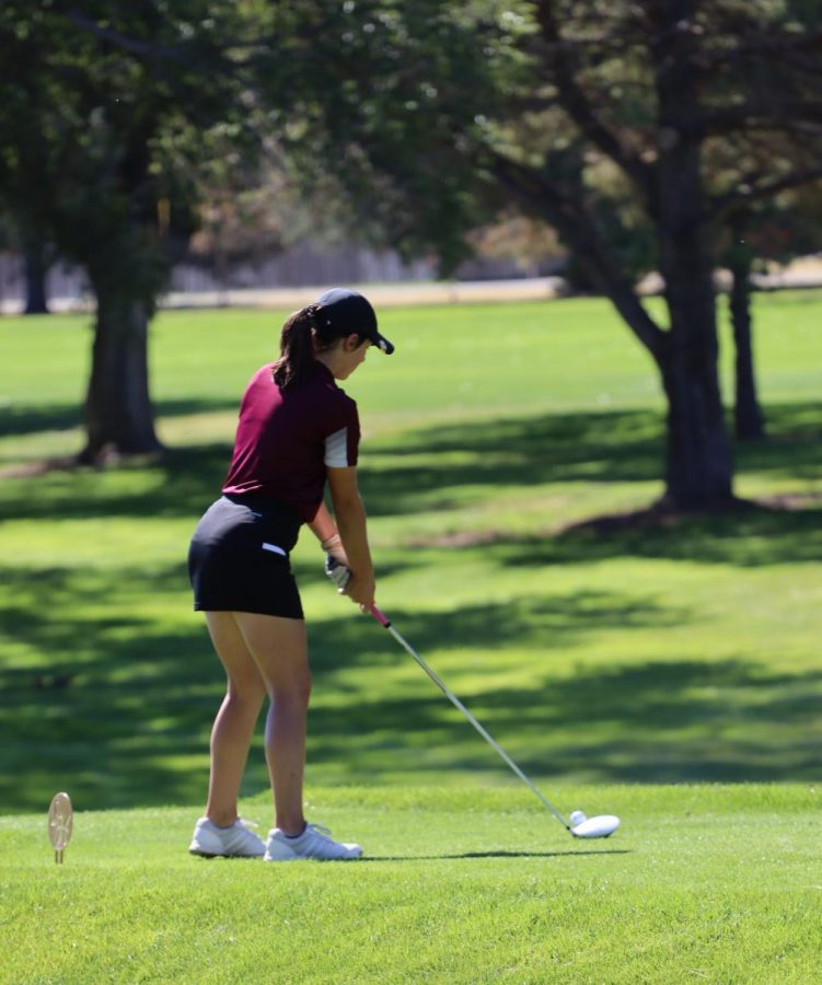 Sophomore Lily Garrison prepares to take her drive at the TMP Invitational Golf Tournament at Smoky Hill Country Club.