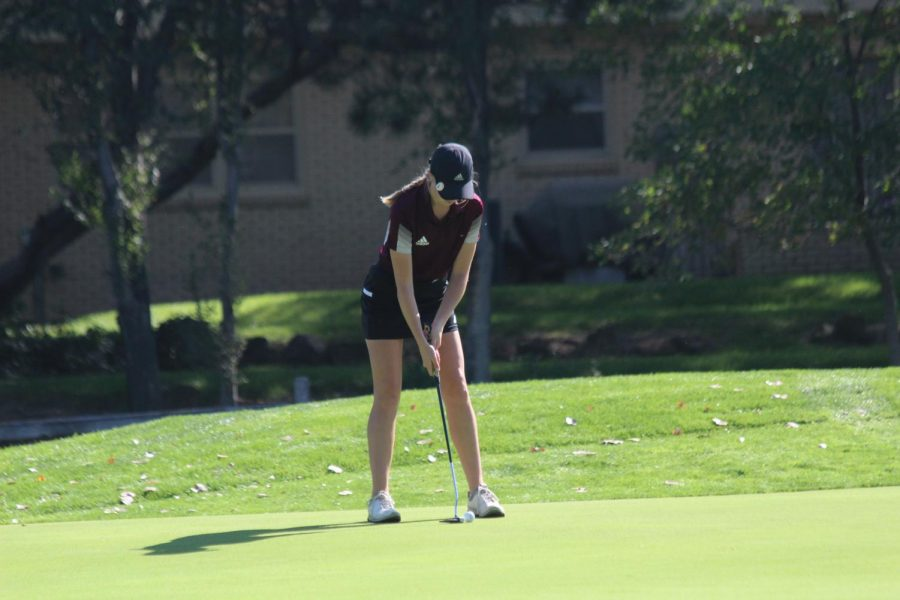 Junior Katie Dinkel lines up her putt at the 5A Regional Tournament hosted by Hays.