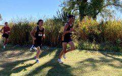 Senior Brayden Hines (left) trails behind senior Landon Viegra (right) at the Allie-T Invitational.